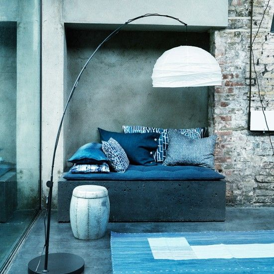 Modern blue and white living room with exposed brick and concrete walls | Industrial chic design room ideas | Homes & Gardens | PHOTO GALLERY | Housetohome.co.uk