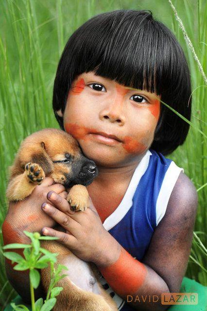 Indigenous child with dog, Amazon. Brazil - David Lazar