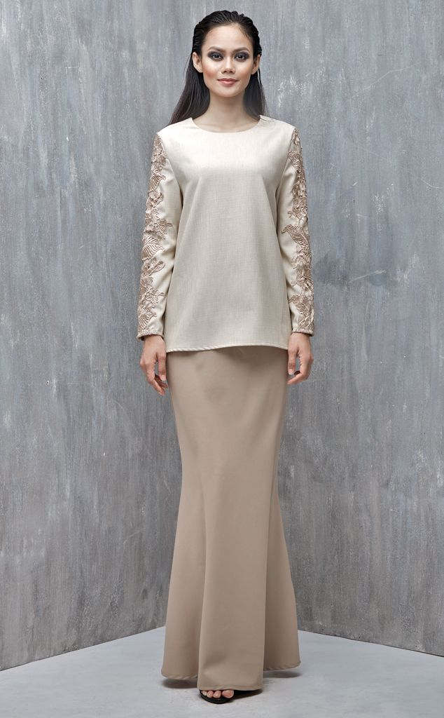 EMEL X DAPHNE IKING - LONGHORN - Modern A-line Baju Kurung with Lace (Nude) This A-line modern baju kurung is all about the class and simplicity with border lace on the sleeves. Also, the top is a tweed inspired fabric that's makes a lovely ensemble with the border lace. #emelxCLPTS #emelxDaphneIking #emelbymelindalooi #bajuraya #bajukurung #emel2016 #raya2016 #DaphneIking #lookbook #aline #lace #nude