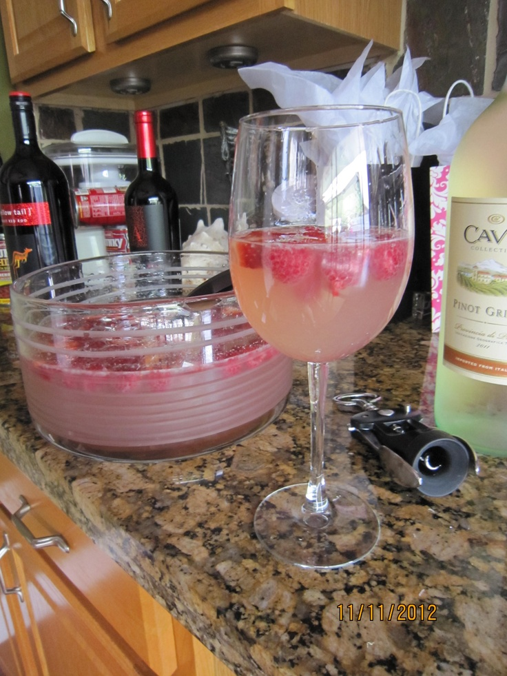 Amazing Punch: 1 large bottle or 2 750ml bottles of any moscato wine, 3 cups of Sprite, 1 pink lemonade concentrate (thawed), raspberries, sliced strawberries. Mix together and enjoy the amazingness!!