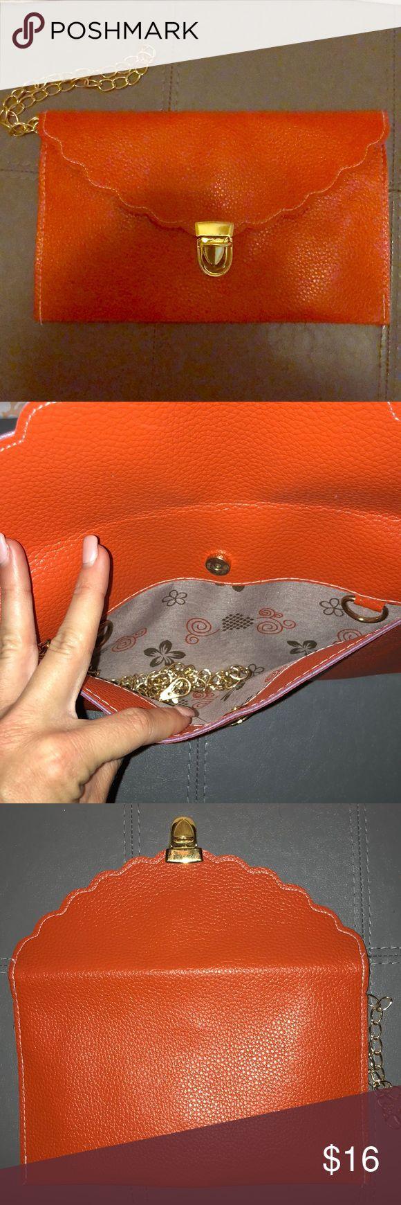 Orange clutch Brand new orange clutch with strap Bags Clutches & Wristlets