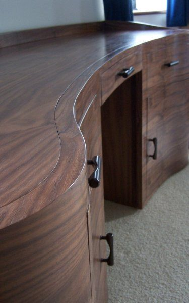 Bespoke curved wooden computer desk with storage. A one-off design to fit  the walls of an oast house.