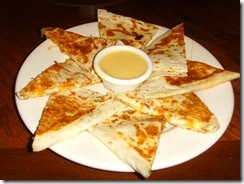 Outback Steakhouse Alice Springs Chicken Quesadilla Recipe-        1 cup Dijon mustard      1 cup honey      1 tablespoon canola oil      1 teaspoon lemon juice      4 -6 boneless skinless chicken breasts      1 tablespoon vegetable oil      2 cups sliced mushrooms      2 tablespoons butter      1/2 teaspoon salt      1/2 teaspoon pepper      12 slices bacon , pre-cooked      3 cups shredded Mexican blend cheese      tortilla    Directions:        1      With an electric mixer combine the…