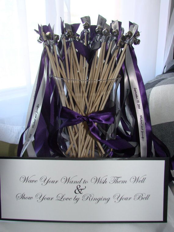 Ribbon wands w/ bells.... Love this idea since our location does not allow the sparklers that we wanted originally.  Thought this was such a cute idea.  Now I have to see where to get them.