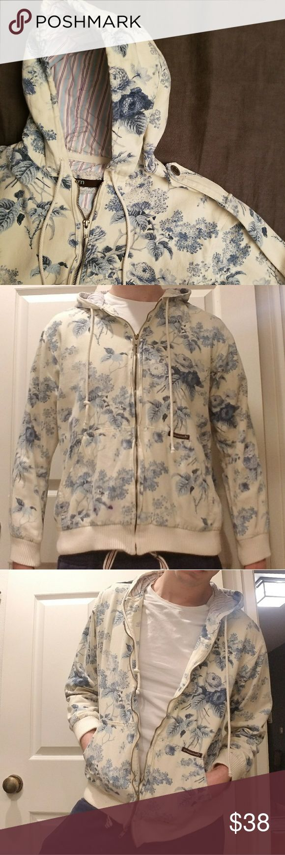grnappletree  Floral Print Canvas Zip Hoodie (m) Oyster white canvas zip hoodie with blue toile floral print.   This hoodie is a fusion of vintage & modern, done in the way only this unique brand can. The ornate Waverly fabric features flowers and leaves offset by military style shoulder straps. The hood is lined with contrast fabric, and all hardware is silver.   **There is a small blue ink stain on the front right pocket (last image). This stain actually pops much more in the image than it…