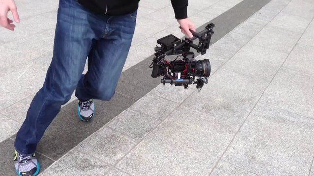 MōVI in Action (Quick Video) by Vincent Laforet. This is a shot of the The MōVI - a digital 3-axis gyro-stabilized handheld camera gimbal. The completely silent device weighs under 3.5 pounds bare and can be operated solo, or with the help of a second gimbal operator with a joystick to pull off some incredible moves. To read more about it go to: wp.me/pjtZ0-2a4 The resulting video from this shoot is at:vimeo.com/62917185 or the BTS:  https://vimeo.com/63357898