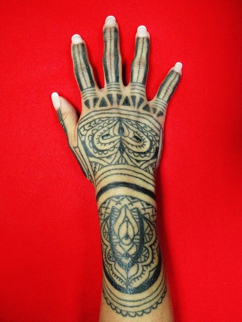 In comparison to western tattoo tradition, tribal eastern tattoos ( Filipino in this example) hand tattoos are not taboo. They are elements of beauty. Female hand tattoos are particularly common and striking....From Needles and Sins tattoo blog- read it!