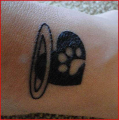 My Tattoo after losing my little dog Maggie June 2011 also a reminder of our cat Mocha who we lost March 2010.