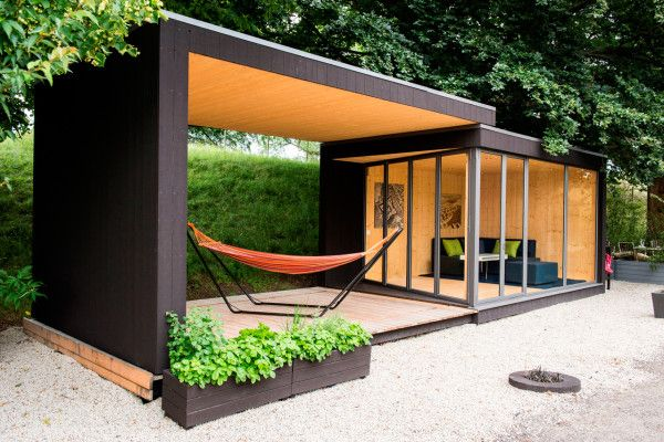 Friluftsstugan/Outdoor Cottage by Kenjo - a prefab structure that comes witha moveable roof. The upper roof slides out over an exterior wood deck to make a covered outdoor space.