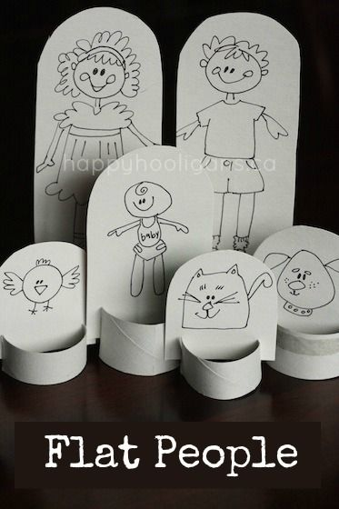 flat people - paper doll family out of cardboard and a toilet roll tube