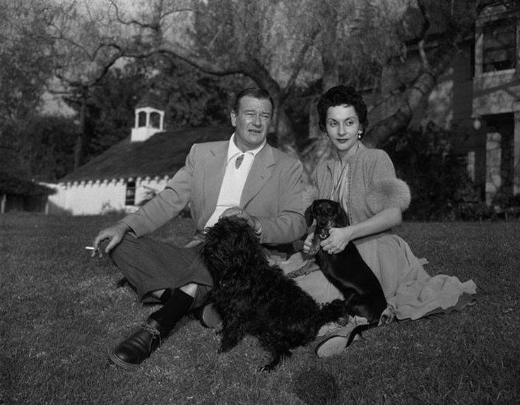 John Wayne with his third wife Pilar Pallete