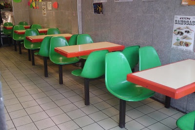 Styling and Salvage: my second favourite 'herman miller clearance sale green fiberglass shell chairs on table/chair combos in fried chicken type greasy-spoon cafe in south london'