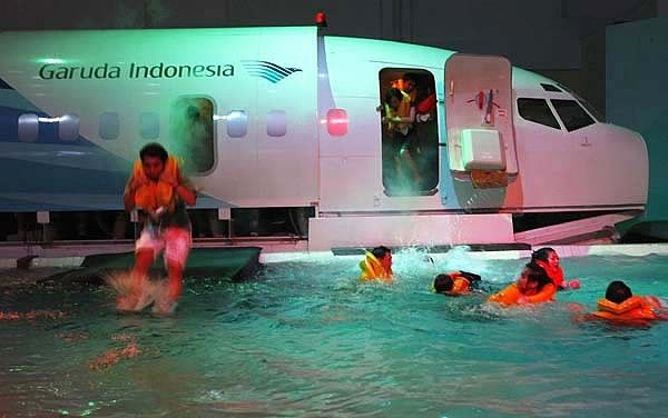 Flight Attendant Training ..ditching..Come this way, inflate vest, jump into the water!