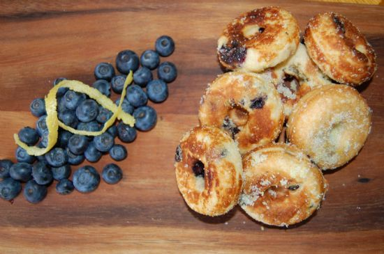 Baked Lemon Blueberry Donuts. I used a mini muffin tin and they came out amazingly tasty. Not bad for you either!