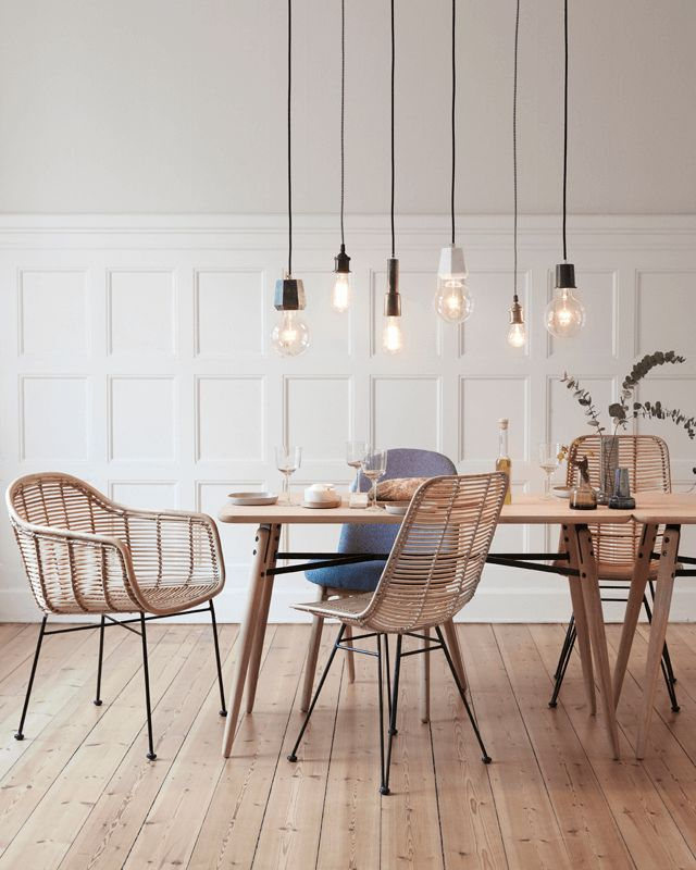 Wicker chairs and pendant lights. #diningroom #interiordesign #pendantlight