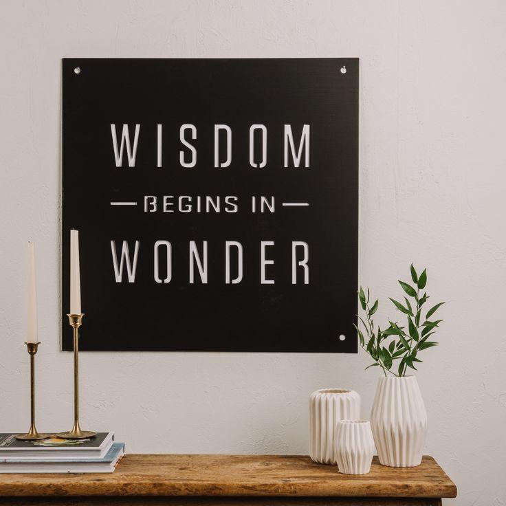 Wisdom begins in wonder sign