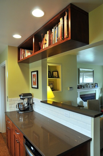 Bungalow kitchen - love the high cookbook shelf.