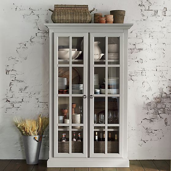 Statuesque Wood Cabinet Shows Its Lighter Side With A Warm Grey Finish And Pane Glass Fronts
