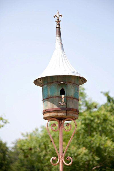 birdhouse ~ I like this round one!  Funnel for a roof I guess!  Fancy pole too.