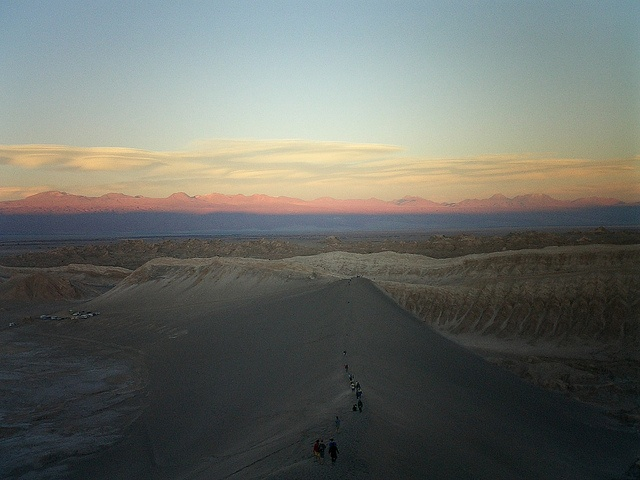 Valle de la Luna - tourists heading up to the top of the sand dunes to catch the sunset view