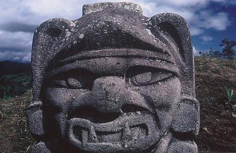 Stone head of warrior in the San Augustin archeological site (San Augustin, Colombia)