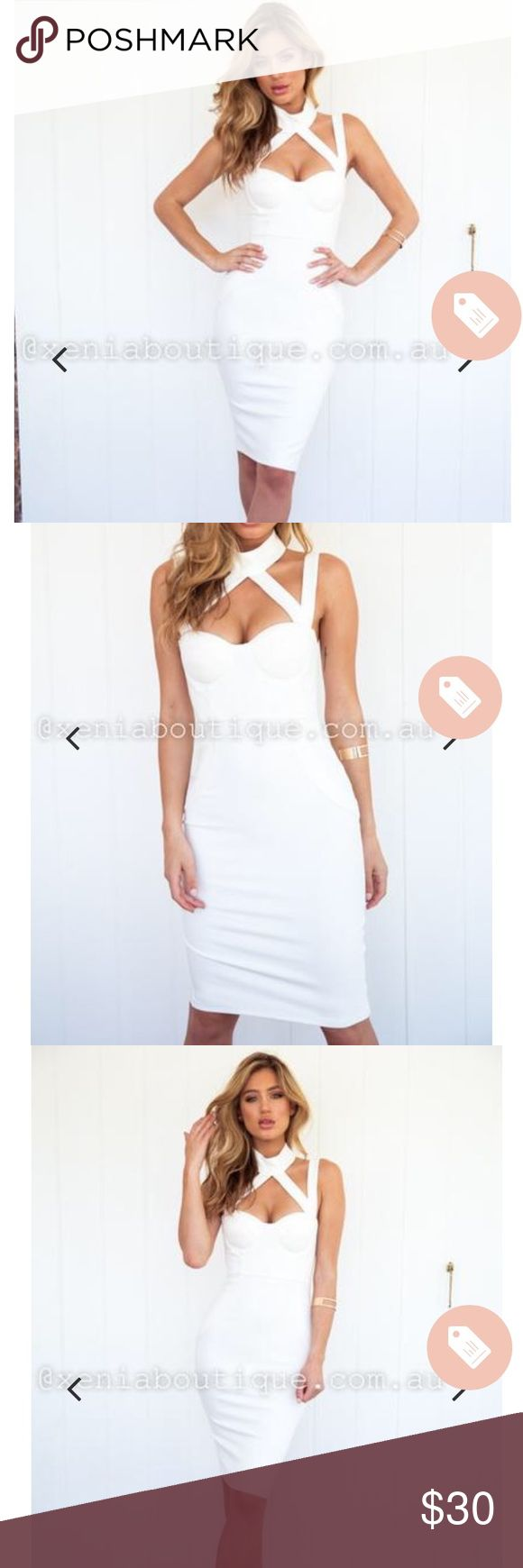 White Xenia bodycon dress Stunning and elegant dress. Very flattering, gives you nice hourglass shape. Only selling because it didn't get here in time! From Australian website, size 8 AUS so size 4 US. BRAND NEW!!! PHOTO CREDIT: Xenia Boutique Xenia Boutique Dresses Midi