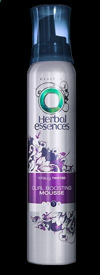 Herbal Essences Totally Twisted curly hair mousse keeps the frizzies down and my curls looking fabulous.