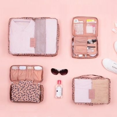 Pattern Ladies Travel Pouch Set from the website MochiThings.com. I need this so badly in my life because I'm an OCD psycho about packing.
