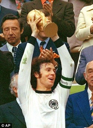 Franz Beckenbauer lifts the World Cup in 1974 for West Germany.