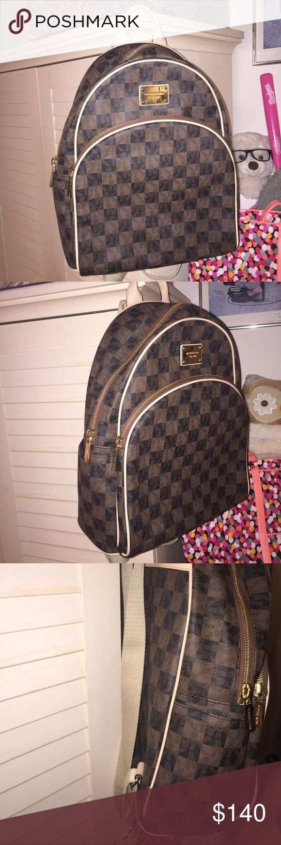 Large size Michael Kors Checkered Backpack School size, worn two times, good condition, minor wear on the patina. never came with a dust bag but will be shipped in another kind. Retail $300 plus tax so my price is FIRM! thanks for looking Michael Kors Bags Backpacks