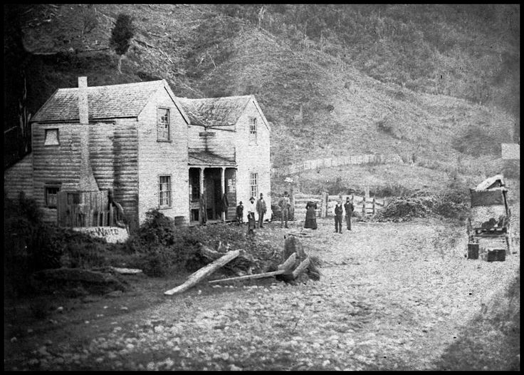 Paremata Hotel, (north of Wellington) c1880s. A group of people gathered outside with a coach parked on the right with cases or chests beside it. What is that word visible below the chimney?  Alexander Turnbull Library/National Library of New Zealand.