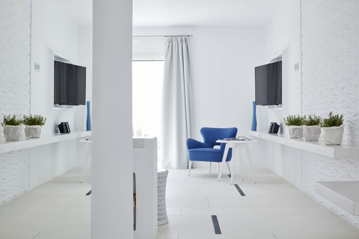 An all-white oasis with touches of blue recalling the aquamarine Ambassador pool immediately below! #Discover #Accommodation #Art #Design #MyconianAmbassador