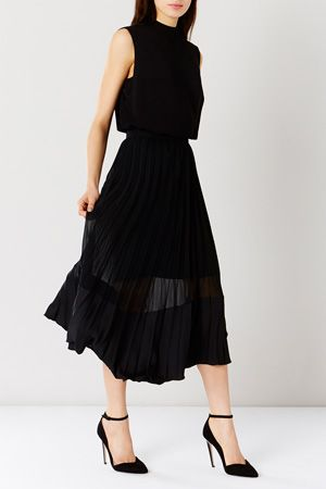 The stunning pleated Evie Pleated Skirt is a truly stunning piece which is lined for a chic peekaboo effect. The lightweight skirt moves effortlessly and features an elasticated nipped-in waist. Maximise the sweeping silhouette with a fluid top for a contemporary look this season.