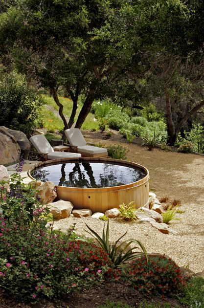 """The ""spool"": Smaller than a swimming pool but larger than your typical spa, the water feature is actually a converted galvanized horse tank. It's not heated like a spa, but rather used as a place to soak on summer's hottest days."""