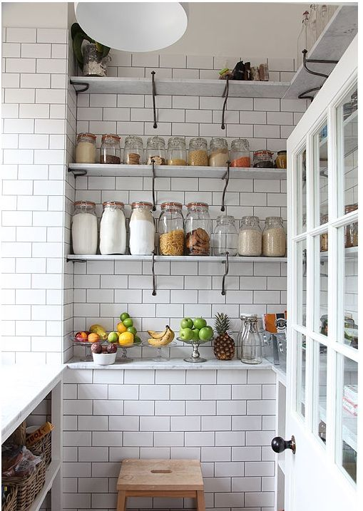 A storage niche completely lined in subway tile.