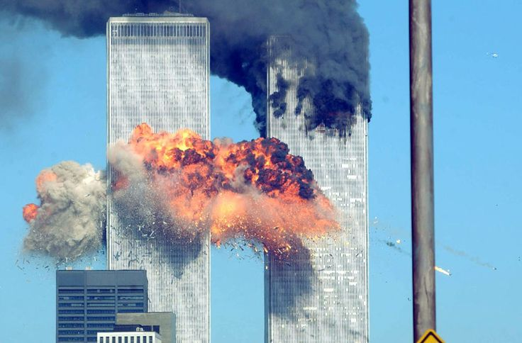 Moments after United Airlines Flight 175, with 56 passengers (including the 5 hijackers) and 9 crew members, struck the South Tower of the World Trade Center between floors 77 and 85 on September 11, 2001, in New York City. (Spencer Platt/Getty Images)