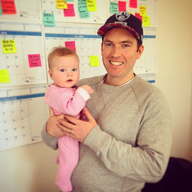 A surprise visitor to the office today, checking in on her dad @ryanmobilia. Thanks to the absent team member whose desk made a terrific make-shift change table! #TeamMobs