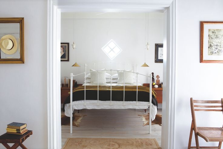 Master bedroom - rug from Gonsenhausers and throw from Madwa. Reconditioned Victorian light fittings. Interiors by Jean-Pierre de la Chaumette.