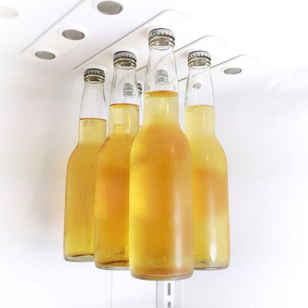 Magnetic Bottle Holder, these insanely strong magnetic strips allow you to hang your beer from the ceiling of your fridge, freeing up space (plus it just looks cool).
