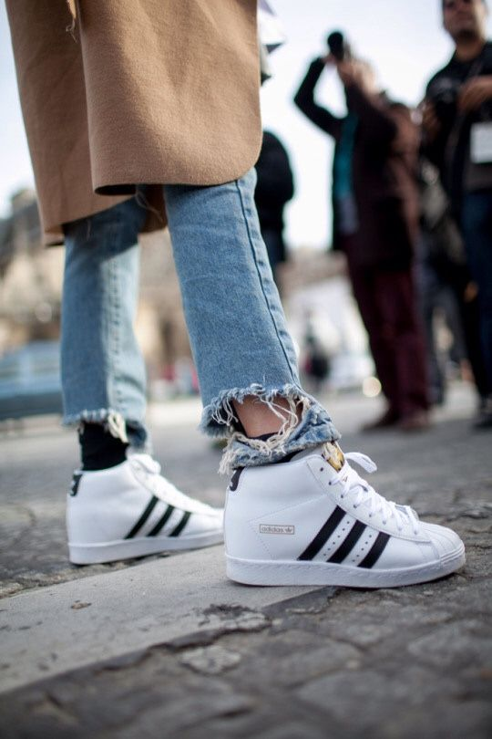 Ripped jeans and adidas Superstar high tops