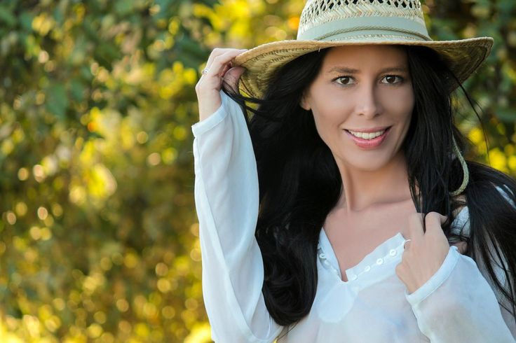 Summertime fun. shot by: Rebel lens photography. Sun hat, straw hat, white lace top. beach.