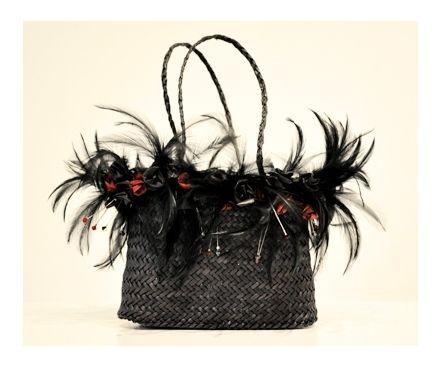Kete Whakairo (harakeke, feathers & swarovski crystals) black with harakeke rosebuds by Jess Paraone