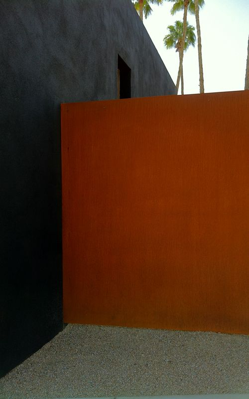 Exterior colors: charcoal grey and rust/copper red - http://www.spryarch.com/gal7_img9_big.jpg