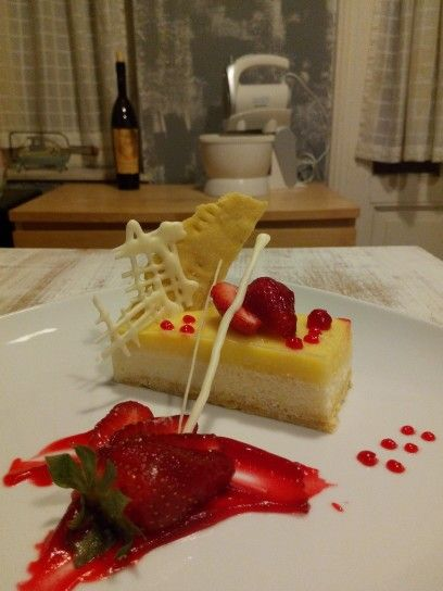 Bavaroise of white chocolate,lemon cream and strawberries sauce!