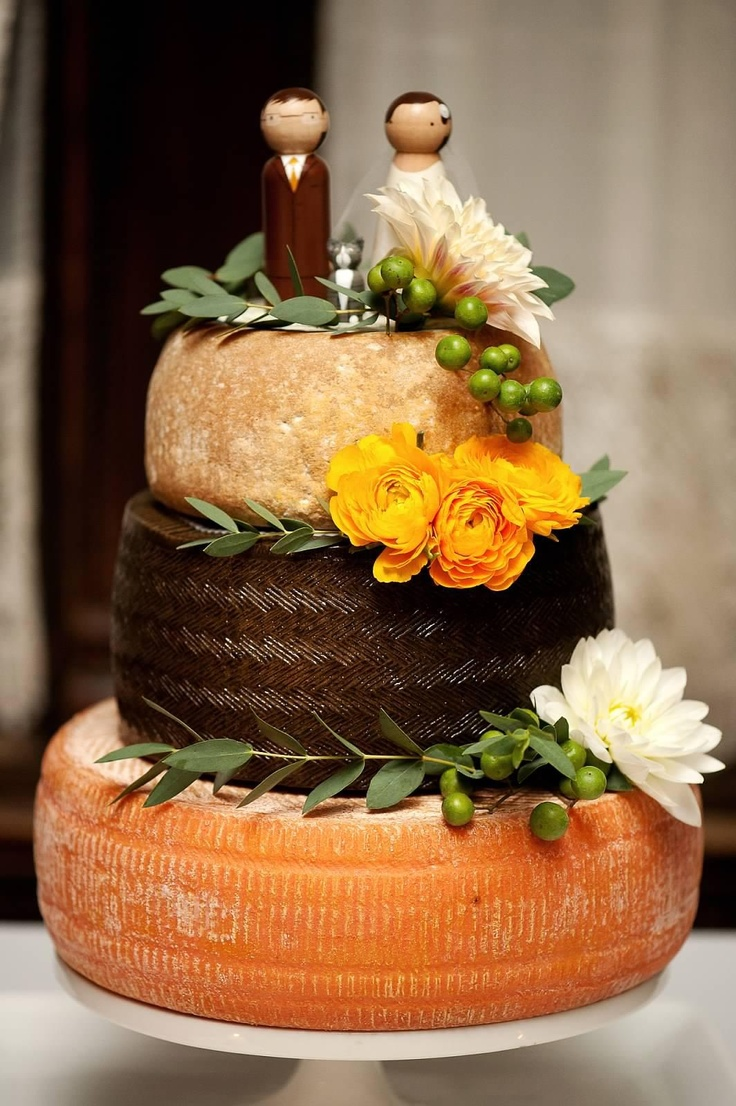A little over a year ago, a couple of lovely customers approached one of our mongers about creating a wedding cake made of cheese. This is the result, and we are proud to show off our collaboration! Credit where credit is due:  Cheeses—top to bottom: San Andreas, Manchego, Pawlet.  Photography—Photo Pink.  Floral decorations-—Rebecca Shepherd.  Custom cake toppers—Knottingwood.