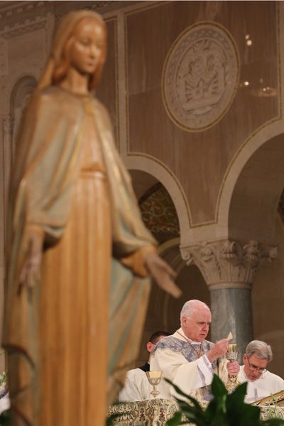 Cardinal O'Brien, grand master of the Knights of the Holy Sepulchre, celebrates Mass at the Basilica of the National Shrine of the Immaculate Conception in Washington Aug. 15, the feast of the #Assumption.