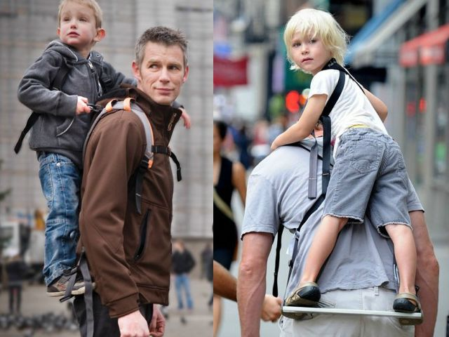 The Piggyback Rider is a simple child carrier that straps to your back like a regular backpack but has a special stand bar located about waist level for the child to stand on while strapped to your back. The child has an excellent view in this standing position. For the adult, the standing position provides a better weight distribution because of the lower center of gravity. The carrier also allows for a natural upright walking posture.