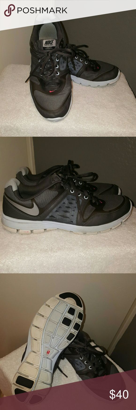 Pre- Loved Women's Nike Free XT- Size 8.5 These are a pair of DARK GRAY colored women's Nike with a silver colored swoosh on outside heel of each shoe. These are 9/10 condition. Fit is true to size, I find this style runs a bit wide. Nike Shoes Sneakers