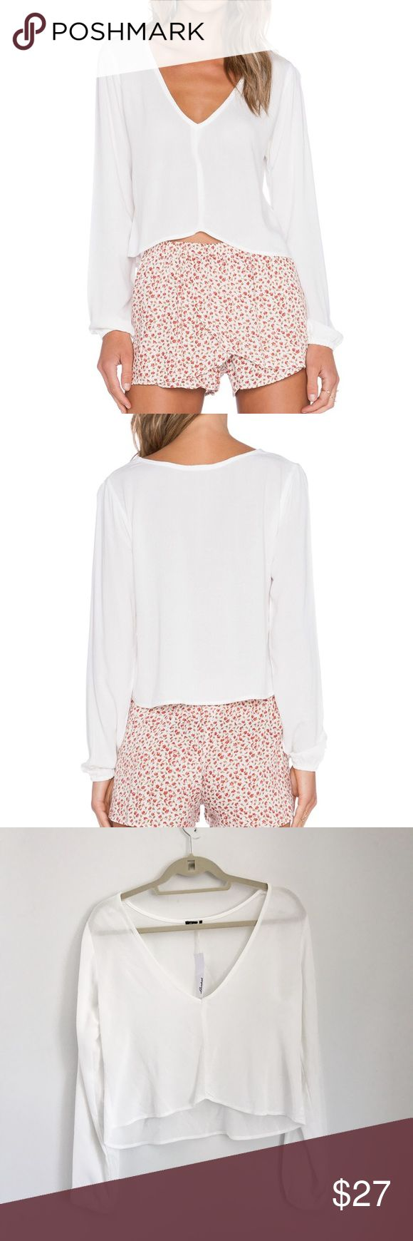 Lisakai White Long Sleeve Top size M NWT Lisakai white long sleeve crop top with an asymmetrical gem (high-low). Super cute with pretty Boho scrunched sleeves at the cuff. Never worn. Purchased for $75 on revolve.com. Lisakai Tops Blouses
