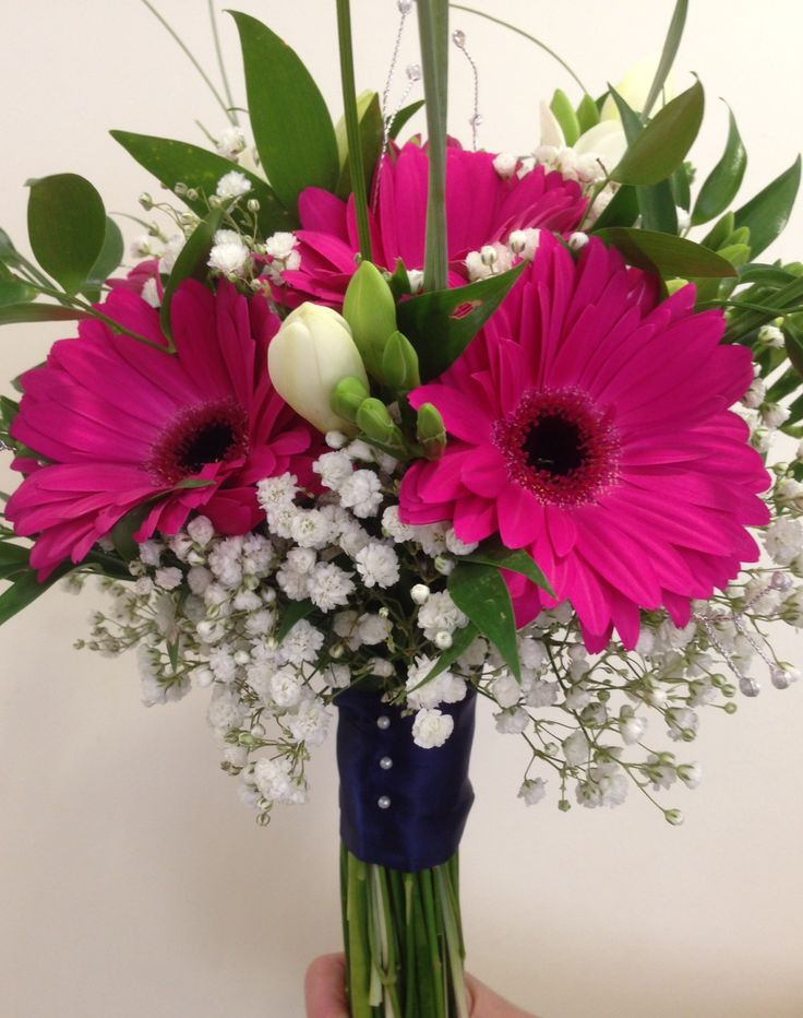 Hot pink gerberas mixed with white freesia in this modern handtied www.am-flowers.co.uk